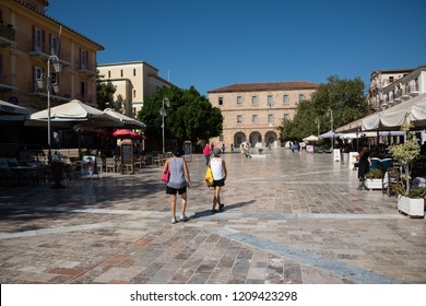 Nafplio, Greece - Sept 16, 2018: People strolling on Syntagma Square in Nafplio, Greece