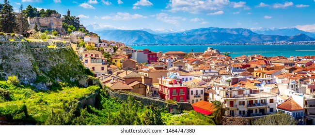 Nafplio or Nafplion, Greece, Peloponnese old town houses aerial panorama and snow mountains banner