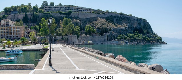 Nafplion,Greece-September 8,2018.A view at the sea promenade of the city and the Palamidi fortress at the background.