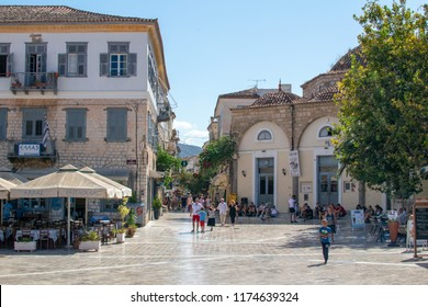 Nafplion,Greece-September 8,2018.People walking at the central square of the city.