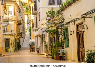 Nafplio-one of the narrow cobblestone alleys with the neoclassical well preserved buildings of the old town.