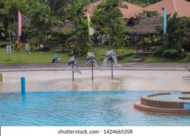 NAGA CITY / PHILIPPINES - CIRCA DEC. 2018: Swimming pool from Haciendas de Naga with the Dolphin Sculptures in Camarines Sur, Philippines