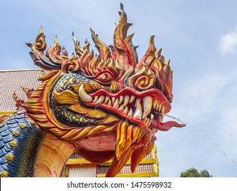 Naga Head a King of Sneak Serpent Statue Colorful big teeth sky background