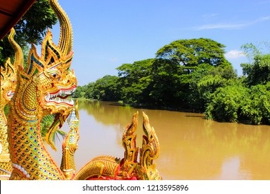 Naga statue is located on the Ping riverside. Chinag Mai, Thailand.