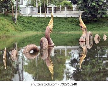 Naga statue in the pond