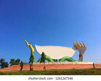 Naga statue in Thailand,In Legend Naga is Protect Buddhism.Naga statue with white copy space in blue sky.