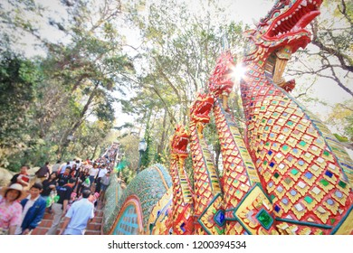 Naga(Big snake) on the gates of Phra That Doi Suthep.  People can climb 309 steps to reach the pagodas. crowded summer Holiday in Chiang Mai Thailand.  Thai temple decoration.