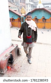 Nagadesh Nepal - April 4 2019 - An elderly man doing his rituals while worshiping in a temple in Nagadesh Bhaktapur Nepal.