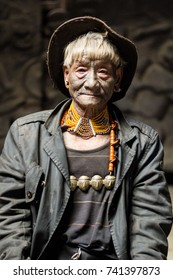 NAGALAND, INDIA FEBRUARY 21 2016: an unidentified naga tribe warrior. The nagas are known for their face tattoos. Each head at the necklace represents a man they beheaded.