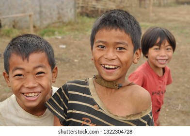 Nagaland, India - March 2012: Happy children smile at camera in Nagaland, remote region of India. Documentary editorial.
