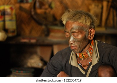 Nagaland, India - March 2012: Man with painted face and necklace in Nagaland, remote region of India. Documentary editorial.