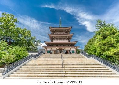 "Nagano City, Japan - August 04, 2017 - Nihon Chureiden Shrine and ""Zenkoji Temple Museum"" inscription at the war memorial pagoda in Zenko-ji temple"