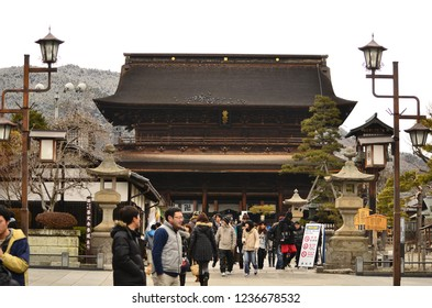 Nagano, Japan- 26 february 2018 : People walking at the Landmark of Nagano city , Zenko-ji temple with beautiful heritage architecture and statue on the sunny day on 26 february 2012 in Nagano, Japan