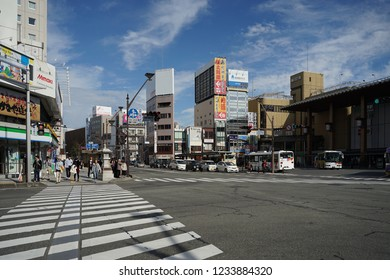 Nagano, Japan- 4 November,2018 : People walking and waiting for the traffic light in front of zebra crossing at The main Nagano train station in the sunny day on 4 November,2018 in Nagano, Japan