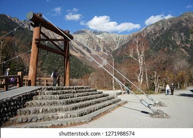 Nagano, Japan- 8 November,2018 : Kuppa bridge the landmark of Kamikochi with beautiful Japanese alps mountain background on 8 November,2018 in Nagano, Japan