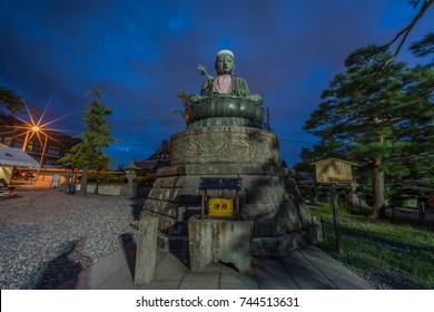 Nagano, Japan - August 03, 2017 : Nure Botoke (Wet Jizo) Bodhisattva Seated bronze statue  of Jizo-Bosatsu protects the temple from fire, Zenko-ji Temple complex in Nagano City.