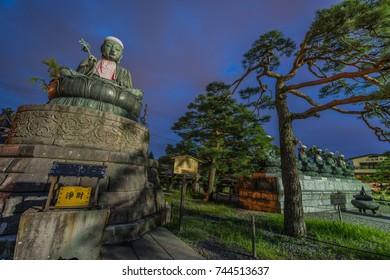 Nagano, Japan - August 03, 2017 : Nure Botoke Jizo  Bodhisattva Bronze statue and Rokujizo statues of the six Bodhisattvas at Zenko-ji Temple complex in Nagano City.