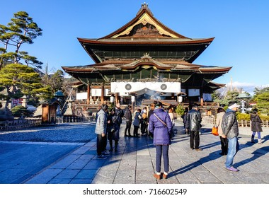 Nagano, Japan - Dec 29, 2015. People praying at Zenkoji Temple in Nagano, Japan. Zenko-ji was founded before Buddhism in Japan split into several different sects.