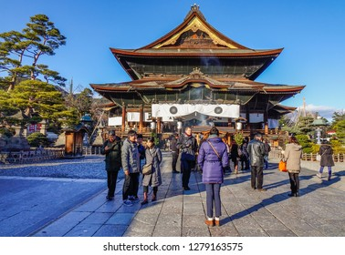 Nagano, Japan - Dec 30, 2015. People praying at Zenkoji Temple in Nagano, Japan. Zenko-ji was founded before Buddhism in Japan split into several different sects.