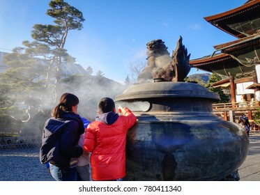 Nagano, Japan - Dec 30, 2015. Local people praying at Zenkoji Temple in Nagano, Japan. Zenko-ji was founded before Buddhism in Japan, split into several different sects.