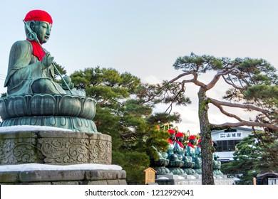 Nagano, Japan - February 04 , 2016, A Buddha bronze statue and Rokujizo statues of the six Bodhisattvas and Jokoro at Zenko-ji Temple complex
