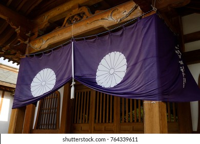 Nagano - Japan, June 3, 2017: Purple temple curtain with a white knot at the Buddhist Zenkoji temple in Nagano