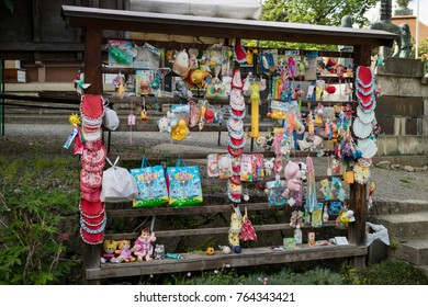 Nagano, Japan -  June 3, 2017: Colorful offerings an dtoys for the patron deity for children and travellers at the Zenkoji temple