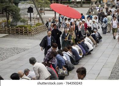 Nagano - Japan, June 3, 2017:  Buddhist female priest is blessing visitors of the Zenkoji temple
