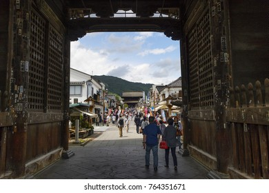 Nagano - Japan, June 3, 2017: Main street lined with tourist shops leading to the Buddhist Zenkoji Temple seen from the Niomon gate