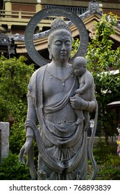 Nagano, Japan -  June 3, 2017: Traditional stone carved Buddhist statue, as the patron deity for children and travellers at the Zenkoji temple