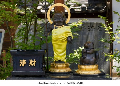 Nagano - Japan, June 3, 2017: Statue of the monk and Mujina, a devoted raccoon dog, at the Buddhist Zenkoji temple according to the legend