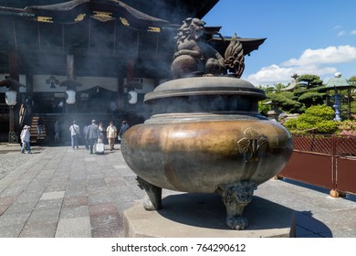 Nagano - Japan, June 5, 2017: Traditional incense burner in front of Zenkoji Temple decorated with a lion dog, Komainu, to ward off evil spirits