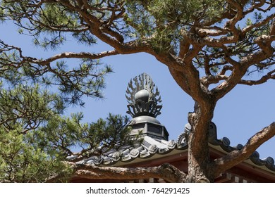 Nagano - Japan, June 5, 2017:  Roof ornament of the Scripture House, Kyozo at the Buddhist Zenkoji temple in Nagan