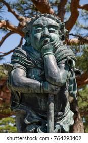 Nagano - Japan, June 5, 2017: Statue near the Fudo Myoo sword at the Buddhist Zenkoji temple in Nagano