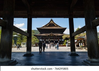 Nagano - Japan, June 5, 2017:  Main hall of the important Buddhist Zenkoji temple in Nagano seen from under the San-mon gate