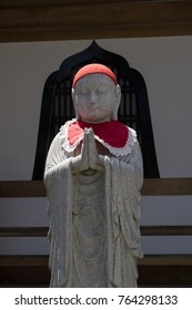 Nagano, Japan -  June 5, 2017: Traditional stone carved Jizo with red skirt and hat at the Zenkoji temple