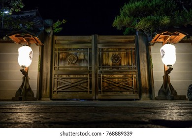Nagano - Japan, June 5, 2017: Illuminated lanterns in front of wooden doors to a temple gate on the road to Zenkoji  in Nagano at night