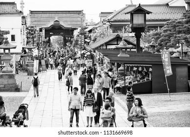 NAGANO, JAPAN - MAY 1, 2012: Tourists visit famous Zenkoji temple on May 1, 2012 in Nagano, Japan. The temple is designated as National Treasure of Japan.