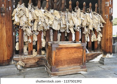 NAGANO, JAPAN - MAY 5, 2016 : Waraji or traditional straw sandals hung as offerings in front of the Niomon Gate of Zenkoji temple, Nagano, Japan.