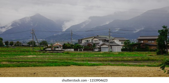 Nagano, Japan - Oct 4, 2017. Mountain township at misty day in Nagano, Japan. Nagano is a mountainous, landlocked prefecture in the center of Honshu.