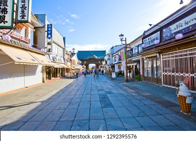 Nagano, Japan - October 23, 2018 : Nakamise street is shopping street in Zenko-ji Temple, Japan. A crowd of tourists are visiting the souvenir and religious items shops on each side.