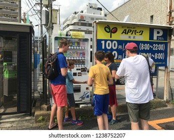 Nagano, Nagano Prefecture/Japan - July 13, 2018: A western family gathers around a Japanese vending machine in Nagano