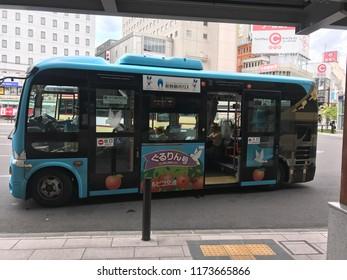 Nagano, Nagano Prefecture/Japan - July 8, 2018:  A Japanese decorated bus used to take tourists to the cedar forest shrines of  Togakushi Okusha near Nagano