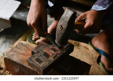 Nagaon, Assam, India. February 11, 2019. Worker making silver jewellery in a traditional method in a Assamese jewellery manufacturing unit.