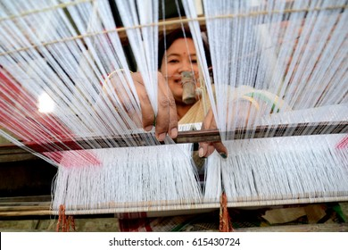 Nagaon, India, April 05,2017: An Assamese woman busy in weaving traditional cloths on hand loom for Bihu festival of Assam, India.