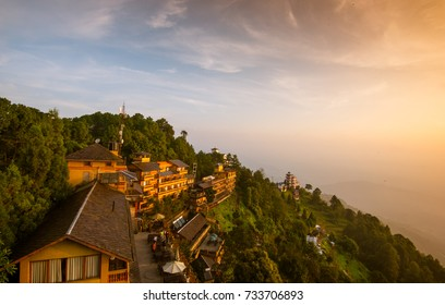 Nagarkot, Kathmandu, Nepal - Circa September 2017 - A beautiful sunrise shot taken from abandoned building rooftop overlooking Hotel Country Villa with mountains background