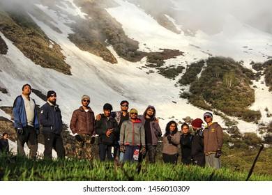 NAGARU, KASOL, HIMACHAL PRADESH, INDIA MAY 2019 group of trekker enjoying evening at nagaru campsite