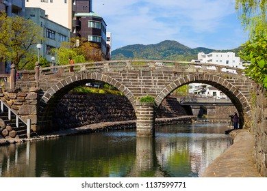 Nagasaki, Japan, 04/24/2017, Ocular bridge. The ocular bridge is a stone two-arch bridge over the Nakasima river in Nagasaki, Japan. A valuable cultural landmark of Japan.
