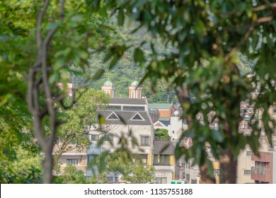 Nagasaki, Japan - 14JUL2018:  Far away view through vegitation of Urakami Cathedral in Nagasaki, Japan.