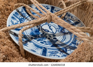 Nagasaki, Japan - October 22, 2018:Japanese Arita blue white porcelain VOC plate 17th C Decorated in Chinese Kraak style with logo of the Dutch East India Company VOC ready for shipping